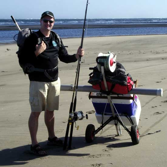 Beach cart loaded with fishing tackle, two cooler bins and kite fishing rigs